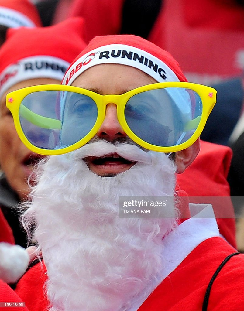 A man wears fake glasses as he takes part in a Santa Claus themed race in downtown Milan on December 16, 2012.
