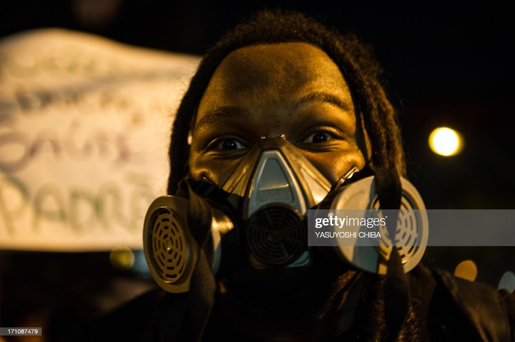 A man wears in a gasmask during a demonstration in Belo Horizonte, Brazil, on June 21, 2013. Brazil's embattled president Dilma Rousseff was to address the nation late Friday, a day after more than one million people marched to demand better living conditions, her office said.