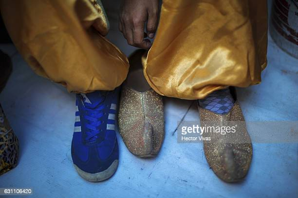 A man wears slippers of Wise Man during the Three Wise Man celebration on January 06 2017 in Mexico City Mexico The Three Wise Man day also known as...