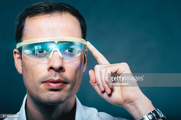 Man wears technology glasses with a visual screen