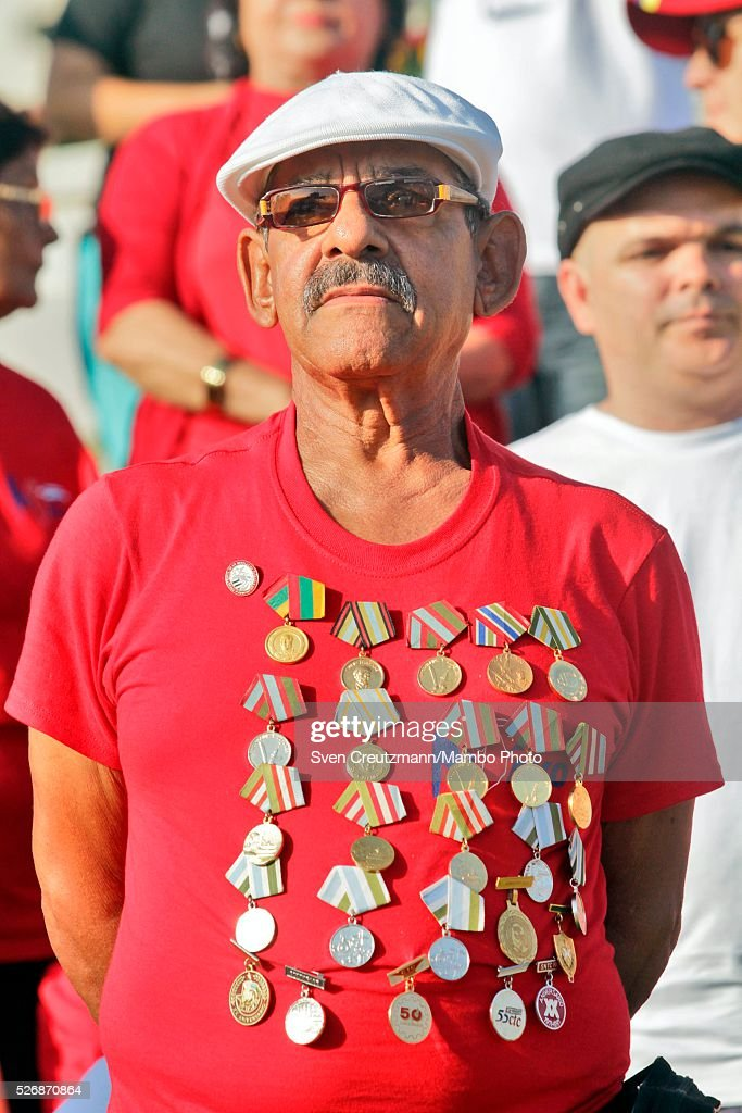 A man wears tens of medals on his T-shirt as he observes a march celebrating workers day, at the Plaza de la Revolucion, on May 1, 2016 in Havana, Cuba. Cuba celebrates workers day shortly before the arrival of the first US American cruise ship to arrive in Cuba, on Monday, May 2, 2016.