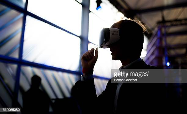 A man wears the HeadMounted Display Oculus Rift on February 24 2016 in Berlin Germany Facebook presented its Innovation Hub where new technology and...