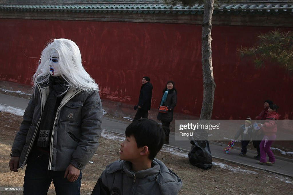 A man wears the mask to visit the Spring Festival Temple Fair at the Temple of Earth park on February 12, 2013 in Beijing, China. The Chinese Lunar New Year of Snake also known as the Spring Festival, which is based on the Lunisolar Chinese calendar, is celebrated from the first day of the first month of the lunar year and ends with Lantern Festival on the Fifteenth day.