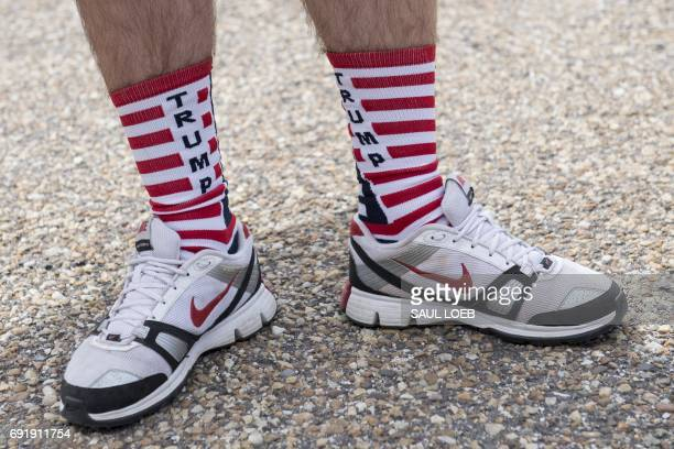 A man wears Trump socks as supporters of US President Donald Trump and his policies demonstrate during a 'Pittsburgh Not Paris' rally in support of...