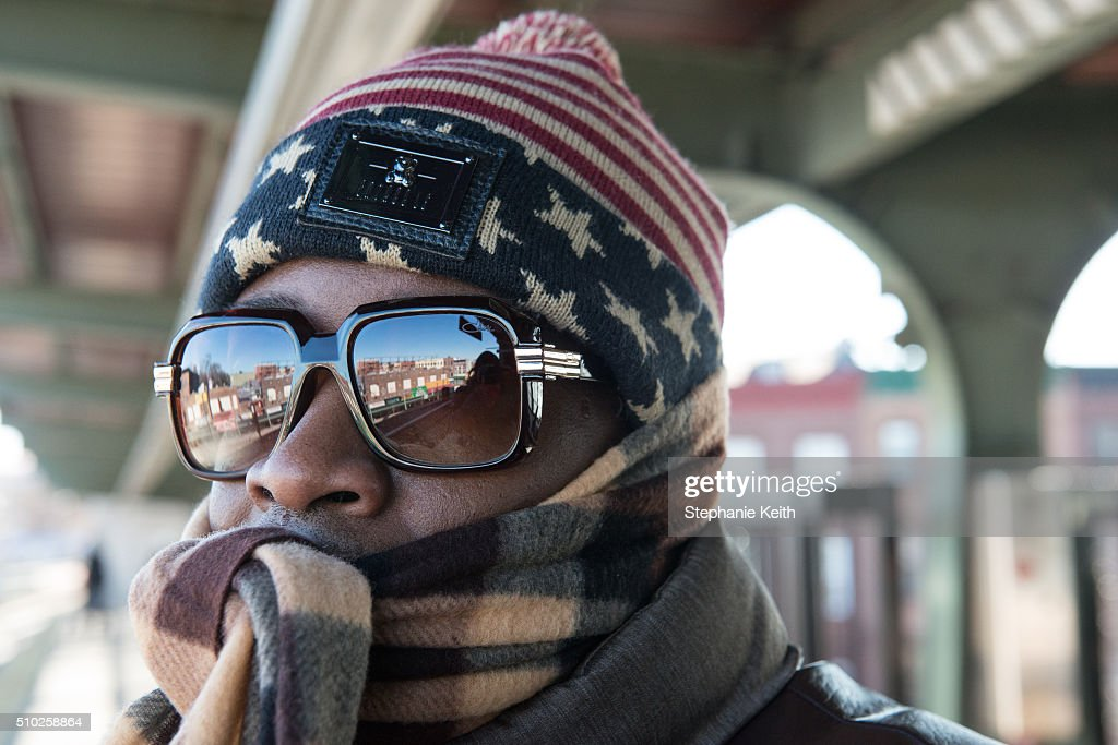 A man wears warm winter clothes on a subway platform during an arctic chill that brought frigid temperatures on February 14, 2016 in the Brooklyn borough of New York City. The city broke a 100-year record February 14, as emputures dropped minus 1 degree Fahrenheit.