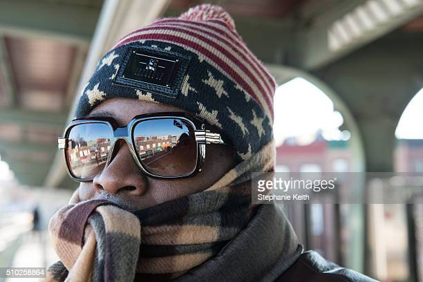 A man wears warm winter clothes on a subway platform during an arctic chill that brought frigid temperatures on February 14 2016 in the Brooklyn...