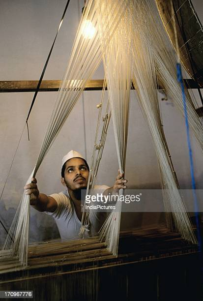 Man weaving Banaras silk Uttar Pradesh India