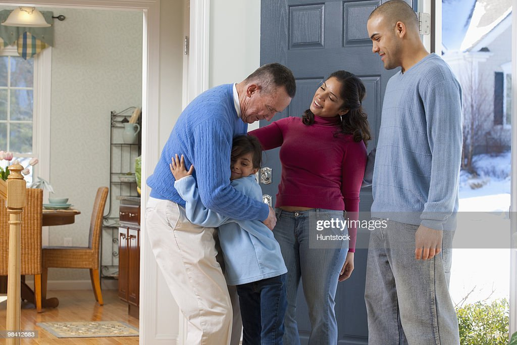 Man welcoming his children and granddaughter