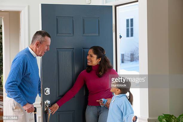 Man welcoming his family