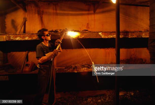 Man welding in workshop