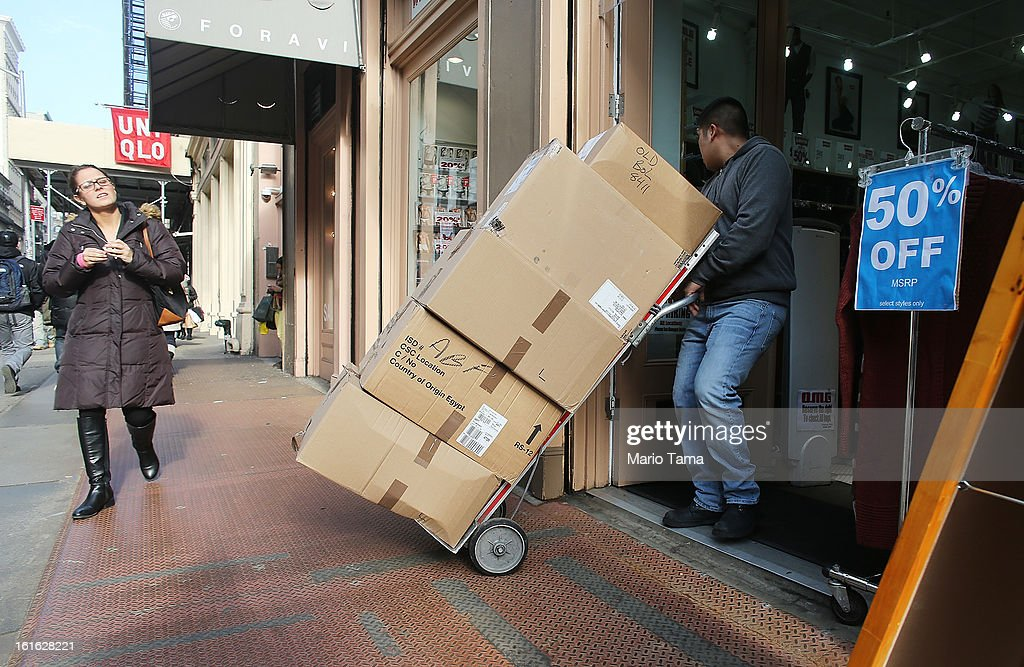 A man wheels boxes into a clothing store on Broadway in Manhattan on February 13, 2013 in New York City. The Commerce Department reported that retail sales were only up slightly in January following tax increases and high gas prices.