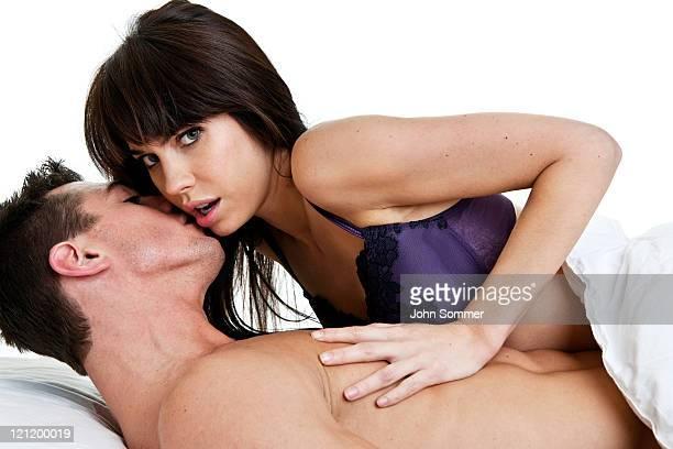 Man whispering in unhappy woman's ear
