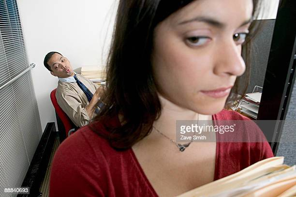 Man whistling at woman in office