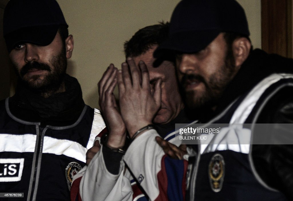A man (C) who attempted to hijack an airliner from Ukraine is escorted by police after the plane was forced down on Febuary 7, 2014 at Sabiha Goksen airport in Istanbul. Turkey scrambled two F-16 jets Friday to force down an airliner from Ukraine when an apparently drunk would-be hijacker ordered it to Sochi where the Winter Olympics opening ceremony was underway. The Ukrainian man, brandishing what he said was a detonator, tried to gain access to the cockpit of the aircraft operated by Turkey's Pegasus Airlines with 110 people on board, officials said.