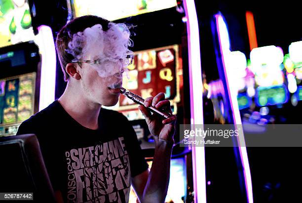 A man who chose to not be indentified exhales vapor while smoking an ecigarette at a casino in Las Vegas NV on Thursday May 1 2014 A study to be...
