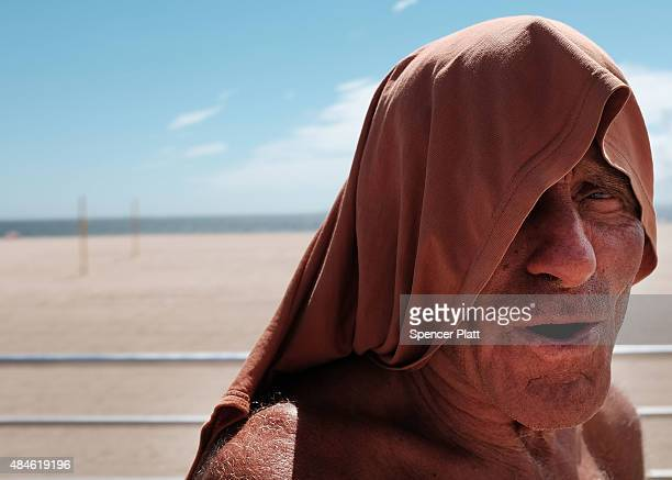 A man who goes by Ricky Obama tries to keep cool in the heat at Brighton Beach in Brooklyn on August 20 2015 in New York City The National Oceanic...
