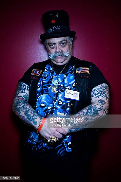 A man who goes by the name Dozer displays his tattoos at the 12th Annual New York City Tattoo Convention at Roseland Ballroom in Manhattan