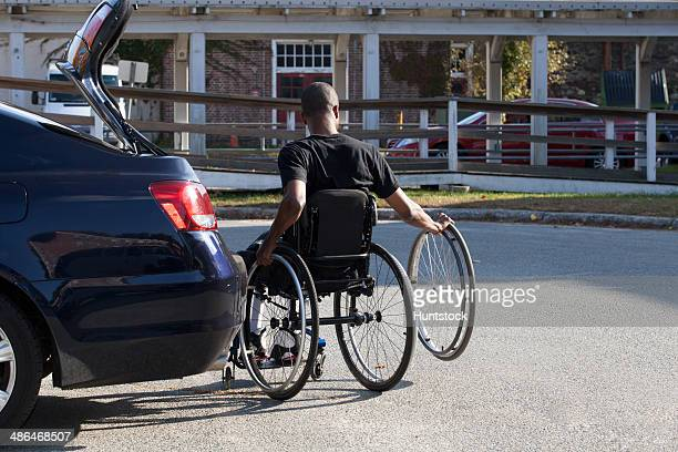 Man who had Spinal Meningitis in wheelchair entering his accessible vehicle
