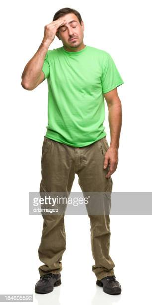 Man who is stressed rubbing his forehead with his hand