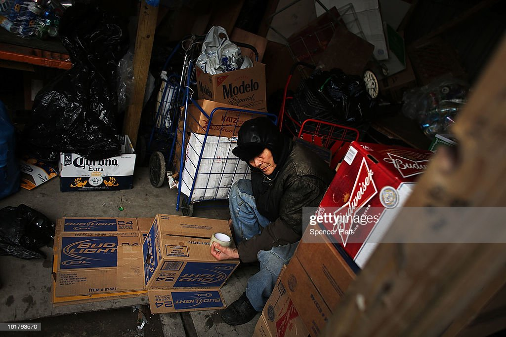 A man who makes a living by collecting bottles and cans or 'canning' for short, pauses while sorting bottles at Sure We Can, a non-profit bottle redemption center in Bushwick, Brooklyn that is pushing to become a cooperative for the canning community on February 16, 2013 in New York City. Sure We Can, which was partly started by homeless canners in 2007 and is run by one of its founders Sister Ana Martinez de Luco, looks to give the diverse members of the canning community a safe and fraternal place to redeem cans, store their carriages and become members of an association that encourages self-dependence and responsibility. Many of New York's canners are non-English-speaking elderly immigrants who live a marginalized existence and are vulnerable to dishonest business practices. Sure We Can currently serves around 50 canners per day and recycles over 6 million bottles and cans per year.