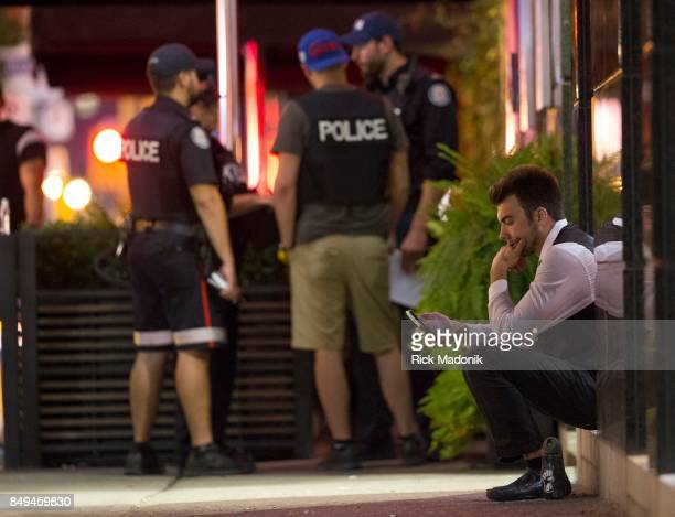 A man who might be the valet parking attendant sits outside while police investigate A shooting occurred at Michael's restaurant in the entertainment...