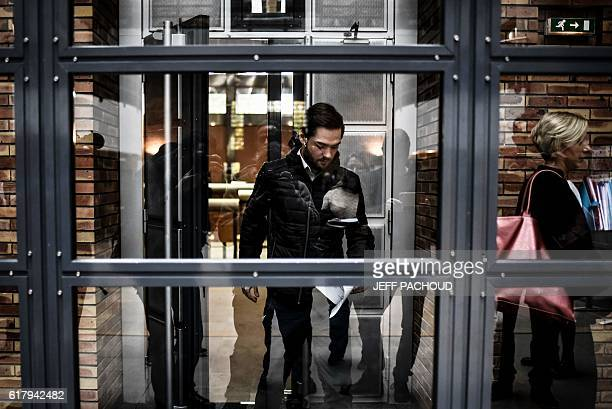 A man who was arrested for destroying hardware with a petanque ball in an Apple Store in Dijon arrives for his trial at court in Dijon eastern France...