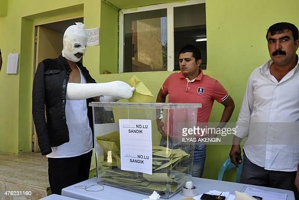 A man who was wounded during the proKurdish People's Democratic Party HDP rally's attack on June 5 casts his vote on June 7 2015 in the southeastern...