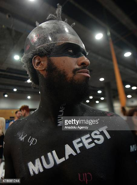 A man whose body was painted by a body painting artist is seen during the MULA Fest the festival of Madrid urban trends at the Madrid exhibition...