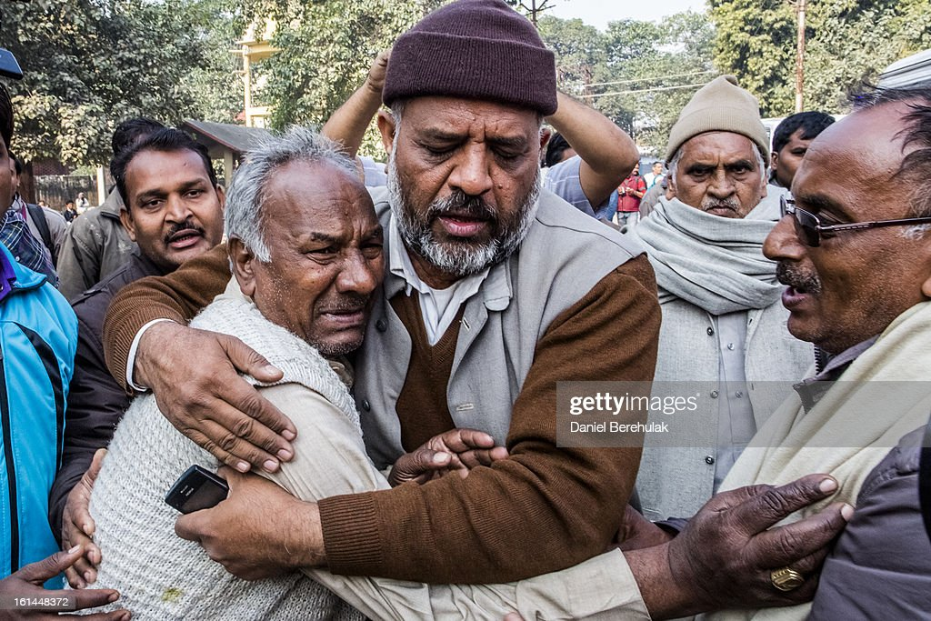 A man, whose wife was killed in last night's stampede, is consoled whilst arranging the release of her body on February 11, 2013 in Allahabad, India. According to a government sources report, at least 36 people died in a stampede at Allahabad station as a train was pulling up on the busiest day of the Maha Kumbh Mela. The Maha Kumbh Mela, believed to be the largest religious gathering on earth, is held every 12 years on the banks of Sangam, the confluence of the holy rivers Ganga, Yamuna and the mythical Saraswati. The Kumbh Mela alternates between the cities of Nasik, Allahabad, Ujjain and Haridwar every three years. The Maha Kumbh Mela celebrated at the holy site of Sangam in Allahabad, is the largest and holiest, celebrated over 55 days, and is expected to attract over 100 million people.