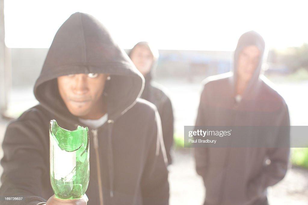 Man wielding broken bottle