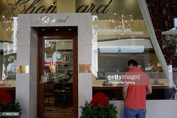 A man window shops looking at the goods inside the shop of designer label Chopard on July 6 2015 in Athens Greece Politicians in Europe and Greece...