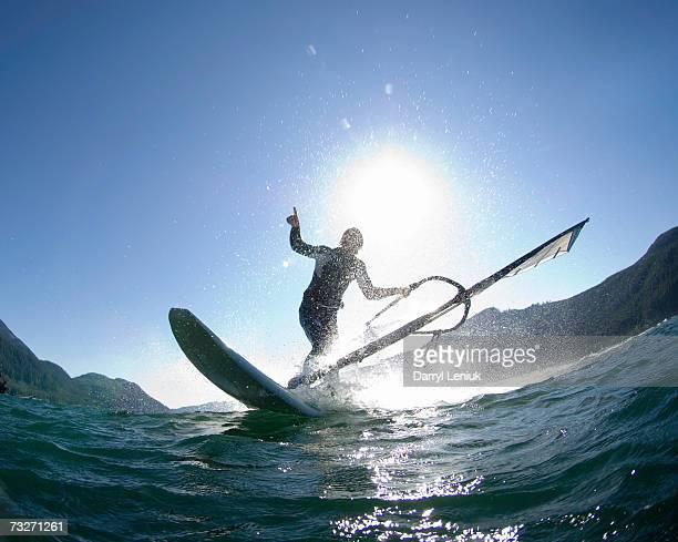 Man windsurfing, silhouette