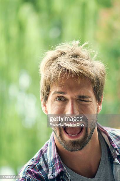 Man winking playfully, portrait
