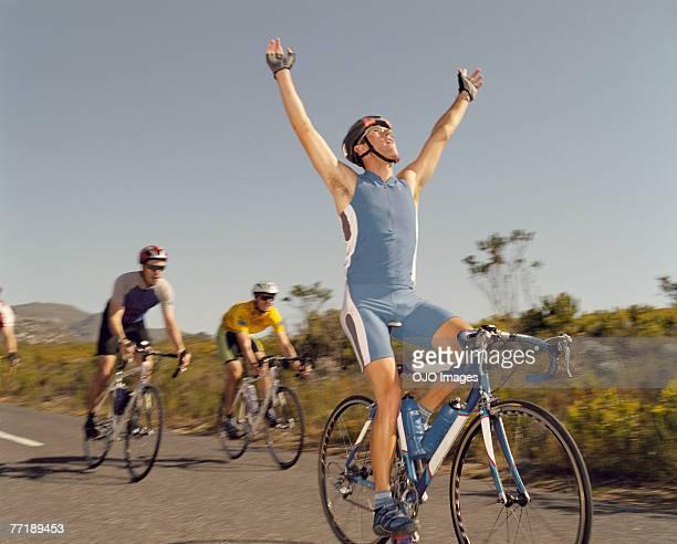 A man winning a bike race