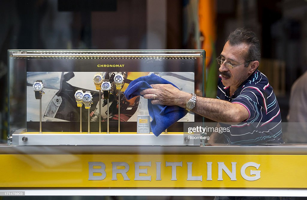 A man wipes down a display case in the window of the Breitling watch store, operated by Breitling SA, on New Bond Street, London, U.K., on Monday, June 24, 2013. Bank of England Governor Mervyn King said the global economic recovery is at risk of further setbacks and central banks are a long way off tightening monetary policy. Photographer: Jason Alden/Bloomberg via Getty Images