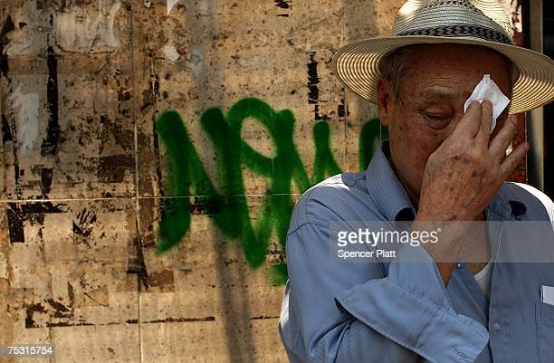 A man wipes sweat from his face July 10 2007 in New York City New York City is experiencing a second day of a heat wave with temperatures in the...