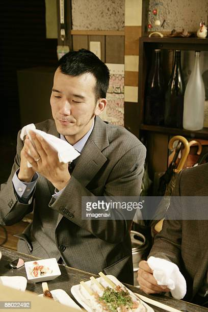Man wiping hands with the hand towel