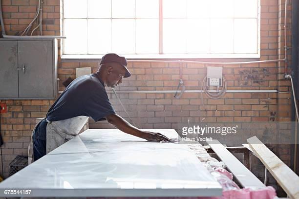 Man wiping marble marble slab