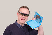Man with 3D glasses and 3D blu-ray disc