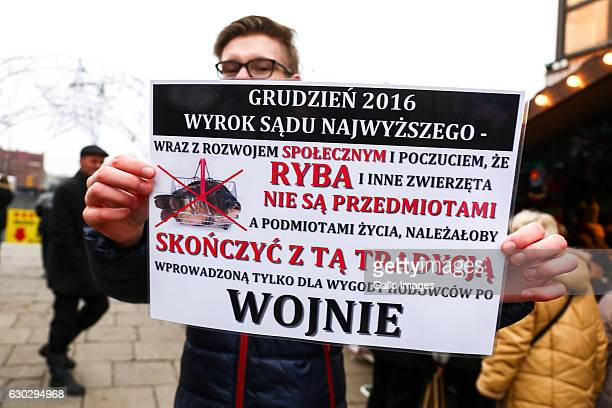 A man with a banner participates in the social action against bloody Christmas on December 18 2016 in Gdansk Poland The movement is opposed to the...