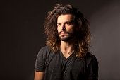 handsome young man with a beard and long hair