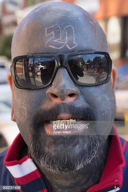 Man with a beard gold teeth and head tattoo in Toronto Ontario Canada