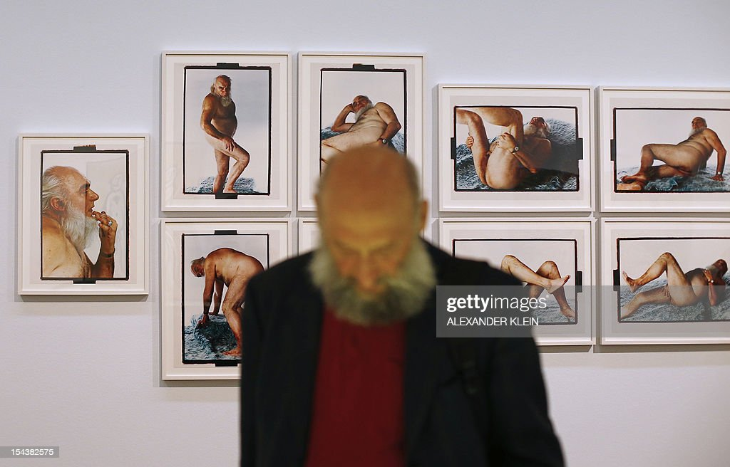 A man with a beard passes by an artwork by Croatian artist Tomislav Gotovac, entitled 'Foxy Mister', as part of the 'Nackte Maenner' (Nude men) exhibition at the Leopold Museum in Vienna, on October 18, 2012. The exhibition takes opens its doors from October 19, 2012 to January 28, 2013.