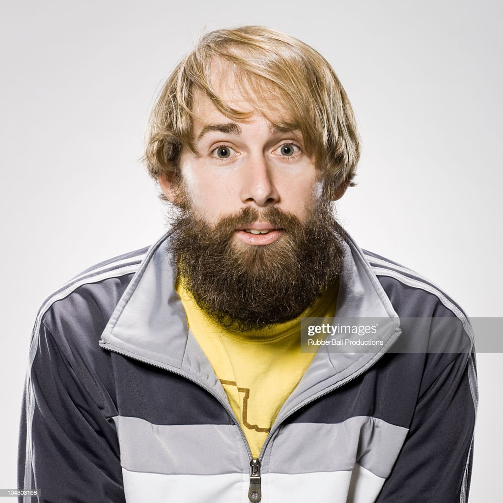 man with a beard wearing a track jacket : Stock Photo