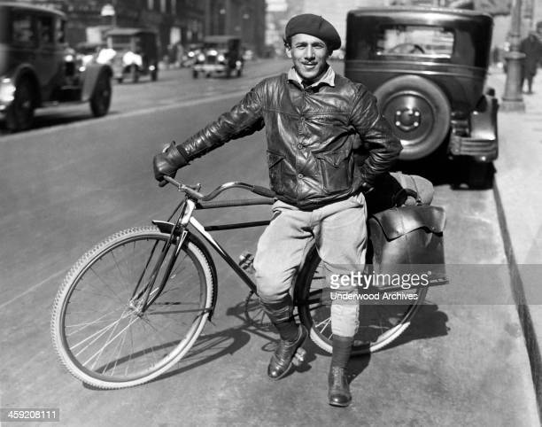 A man with a bicycle for traveling equipped with saddle bags on the rear New York New York circa 1926