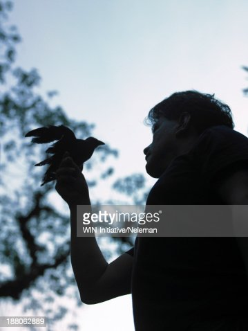 Man with a bird perched on his arm