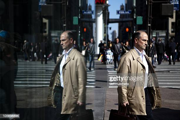 A man with a briefcase walks the streets of Midtown Manhattan home to many of the world's banks on April 9 2009 in New York City