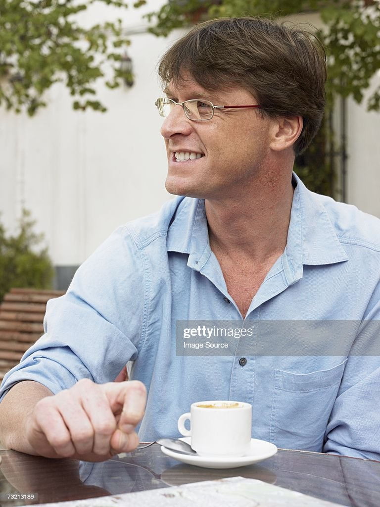 Man with a cup of coffee : Stock Photo