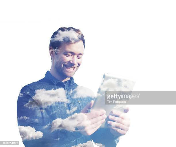 Man with a digital tablet and clouds.