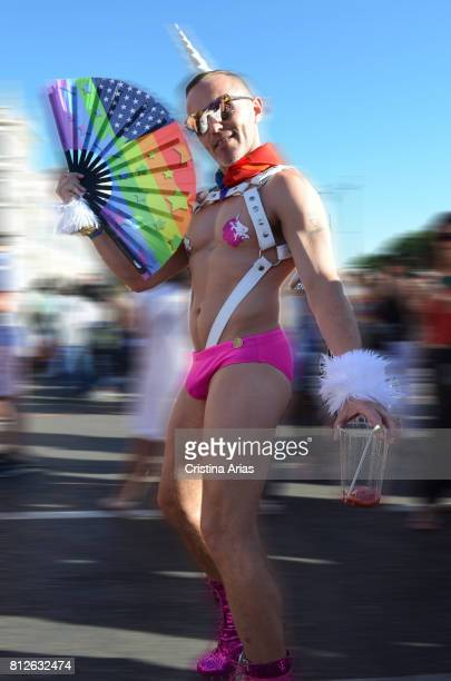 A man with a fan with the rainbow flag during the celebrations of the WorldPride 2017 in the streets of Madrid Spain on July 1 2017
